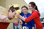 Pix: Shaun Flannery/shaunflanneryphotography.com...COPYRIGHT PICTURE>>SHAUN FLANNERY>01302-570814>>07778315553>>..19th March 2011...............Lakeside Village, Doncaster..Comic Relief Event..In the Stocks, Ashton Harrison gets a soaking from Brodie Sheridan (left) and Emily Prosser.