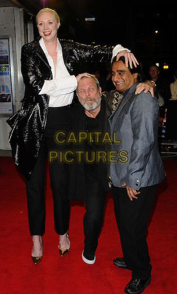 Gwendoline Christie, Terry Gilliam &amp; Sanjeev Bhaskar<br /> &quot;The Zero Theorem&quot; official screening, 57th BFI London Film Festival day 5, Odeon West End cinema, Leicester Square, London, England.<br /> October 13th, 2013<br /> full length black suit beard facial hair shiny blue white shirt crouching funny tall short hand on head<br /> CAP/CAN<br /> &copy;Can Nguyen/Capital Pictures