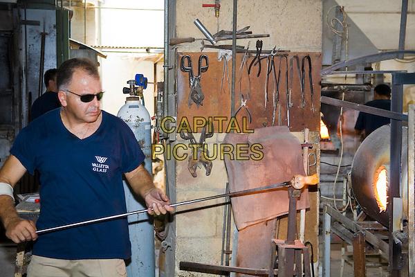 Glass blower manufacturing a glass ornament, Valletta Glass factory, Ta? Qali Craft Village, Malta