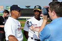 Hall of Fame outfielders Reggie Jackson #44 and Rickey Henderson #24 answer questions from the media before the MLB Pepsi Max Field of Dreams game on May 18, 2013 at Frontier Field in Rochester, New York.  (Mike Janes/Four Seam Images)