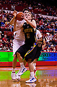 26 November 2011: Nate Wolters (3) of the South Dakota State Jackrabbits drives to the basket against Jorge Brian Diaz (21) of the Nebraska Cornhuskers at the Devaney Sports Center in Lincoln, Nebraska. Nebraska defeated South Dakota State 76 to 64.