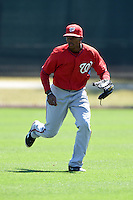Washington Nationals outfielder Rafael Bautista (12) during practice before a minor league spring training game against the Atlanta Braves on March 26, 2014 at Wide World of Sports in Orlando, Florida.  (Mike Janes/Four Seam Images)