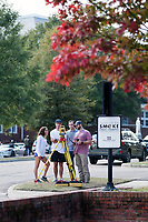 Students doing surveying class assignment with fall leaves.<br />  (photo by Megan Bean / &copy; Mississippi State University)