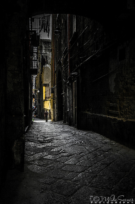 A dark and mysterious laneway in the Historical Centre of Naples in Italy.