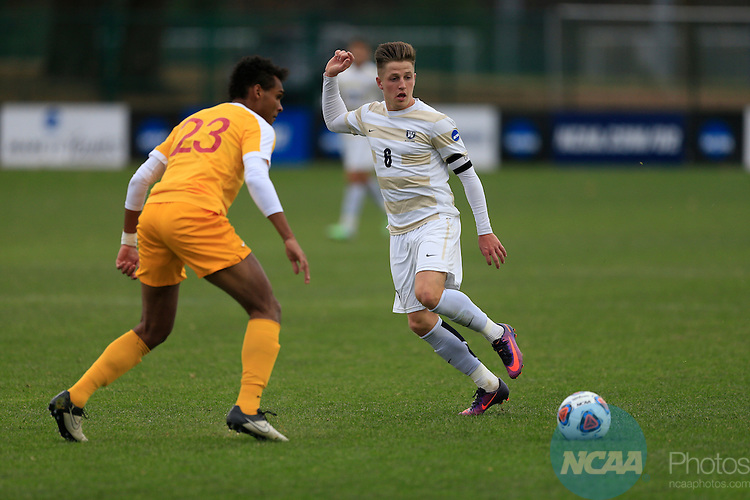 KANSAS CITY, MO - DECEMBER 03:  Williams N'dah (23) of the University of Charleston and Aksel Juul (6) of Wingate University battle for the ball during the Division II Men's Soccer Championship held at Children's Mercy Victory Field at Swope Soccer Village on December 03, 2016 in Kansas City, Missouri. Wingate beat Charleston 2-0 to win the National Championship. (Photo by Jack Dempsey/NCAA Photos via Getty Images)