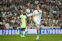 Real Madrid's Croatian midfielder Luca Modric uring the UEFA Champions League match between Real Madrid and Manchester City at the Santiago Bernabeu Stadium in Madrid, Wednesday, May 4, 2016.