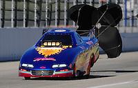Nov 13, 2010; Pomona, CA, USA; NHRA top alcohol funny car driver Mark Woznichak during qualifying for the Auto Club Finals at Auto Club Raceway at Pomona. Mandatory Credit: Mark J. Rebilas-