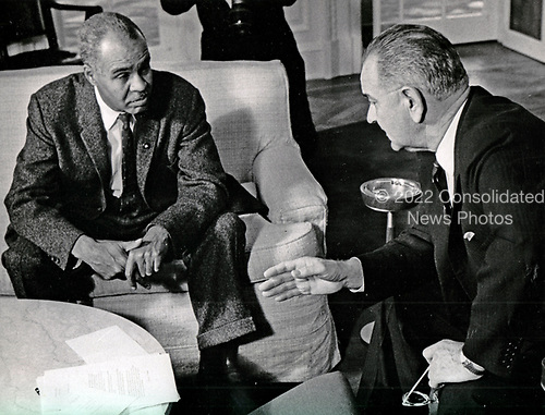 "United States President Lyndon B. Johnson, right, meets with Roy Wilkins, executive secretary, National Association for the Advancement of Colored People (NAACP), left, in the Oval Office of the White House in Washington, DC on November 29, 1963.<br /> Credit: Benjamin E. ""Gene"" Forte"