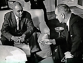 United States President Lyndon B. Johnson, right, meets with Roy Wilkins, executive secretary, National Association for the Advancement of Colored People (NAACP), left, in the Oval Office of the White House in Washington, DC on November 29, 1963.<br /> Credit: Benjamin E. &quot;Gene&quot; Forte