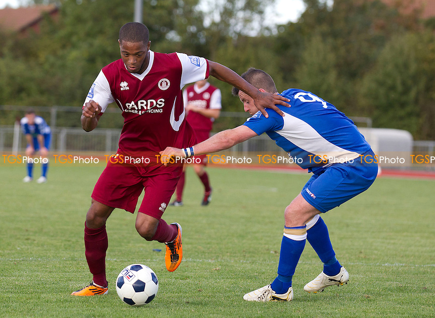 Donovan Simmonds of Chelmsford City tries to get round Stewart Yetton of Truro FC  - Chelmsford City vs Truro City - Blue Square Conference Football at Melbourne Park, Chelmsford, Essex - 29/09/12 - MANDATORY CREDIT: Ray Lawrence/TGSPHOTO - Self billing applies where appropriate - 0845 094 6026 - contact@tgsphoto.co.uk - NO UNPAID USE.