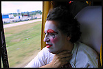 "Eduardo Ravelino ""Raviol"" is seen in the bus as Contrafarsa makes it's way to the inaugural parade of the Uruguayan Carnival. For more than a month, every night after the parade, the Contrafarsa members travel in the same bus from neighbourhood to neighbourhood,  to act in the tablados ( a neighbourhood theatre built specially for the Carnival) in Montevideo, the capital city of Uruguay."