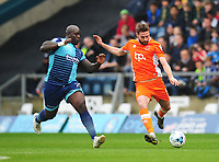 Blackpool's Clark Robertson under pressure from Wycombe Wanderers' Adebayo Akinfenwa<br /> <br /> Photographer Kevin Barnes/CameraSport<br /> <br /> The EFL Sky Bet League Two - Wycombe Wanderers v Blackpool - Saturday 11th March 2017 - Adams Park - Wycombe<br /> <br /> World Copyright &copy; 2017 CameraSport. All rights reserved. 43 Linden Ave. Countesthorpe. Leicester. England. LE8 5PG - Tel: +44 (0) 116 277 4147 - admin@camerasport.com - www.camerasport.com