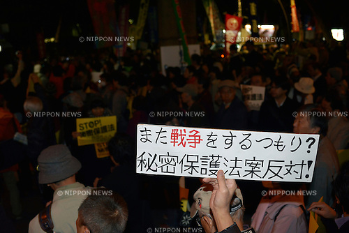 November 21st, 2013 : Tokyo, Japan - People gathered up to protest against a bill on the protection of national secrets, which Prime Minister Shinzo Abe, his party, the Liberal Democratic Party, the Your Party, and the Japan Restoration Party had tried to pass during this diet, at Hibiya Open-Air Concert Hall, Hibiyakoen, Chiyoda, Tokyo, Japan on November 21, 2013. According to a demonstration authority, there were approximately 10,000 people showed up on the Thursday night. (Photo by Koichiro Suzuki/AFLO)