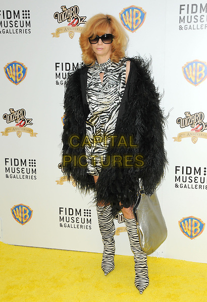 LINDA RAMONE .Warner Bros And FIDM Presents 'The Wizard of Oz Exhibition Opening Night Gala Held at FIDM Museum & Galleries, Los Angeles, California, USA..June 9th, 2009.full length black white zebra animal print dress boots fur coat jacket sunglasses shades .CAP/DVS.©Debbie VanStory/Capital Pictures.