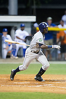 Emilio Gustave (39) of the Princeton Rays follows through on his swing against the Burlington Royals at Burlington Athletic Stadium on August 12, 2016 in Burlington, North Carolina.  The Royals defeated the Rays 9-5.  (Brian Westerholt/Four Seam Images)