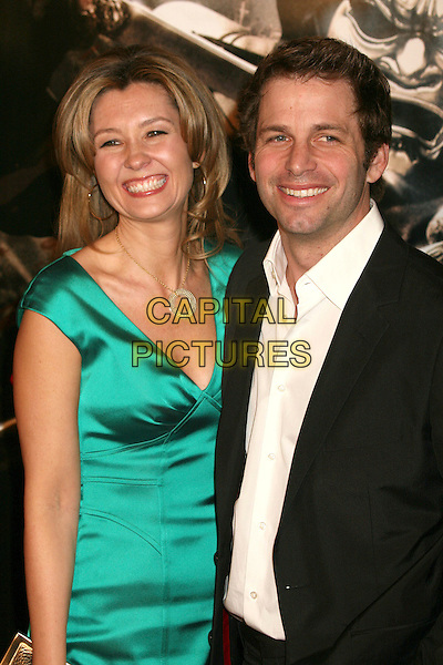 "ZACK SNYDER & WIFE.""300"" Los Angeles Premiere at Grauman's Chinese Theatre, Hollywood, California, USA..March 5th, 2007.half length director black suit jacket green satin dress married husband .CAP/ADM/BP.©Byron Purvis/AdMedia/Capital Pictures"