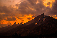 The sun sets behind the Grand Tetons at Grand Teton National Park, Wyoming