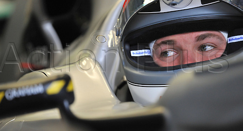 German driver Nico Rosberg of Mercedes GP sits in his car in the box before qualifying at Spa-Francorchamps Circuit near Spa, Belgium