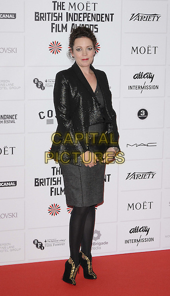 Olivia Colman.The 15th Moet British Independent Film Awards 2012, Old Billingsgate Market, London, England..December 9th, 2012.full length black jacket dress tights clutch bag blazer.CAP/CAN.©Can Nguyen/Capital Pictures.