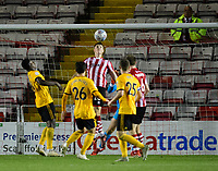Lincoln City's Adam Crookes prevents a goal with a goal-line header <br /> <br /> Photographer Chris Vaughan/CameraSport<br /> <br /> The EFL Checkatrade Trophy Northern Group H - Lincoln City v Wolverhampton Wanderers U21 - Tuesday 6th November 2018 - Sincil Bank - Lincoln<br />  <br /> World Copyright © 2018 CameraSport. All rights reserved. 43 Linden Ave. Countesthorpe. Leicester. England. LE8 5PG - Tel: +44 (0) 116 277 4147 - admin@camerasport.com - www.camerasport.com