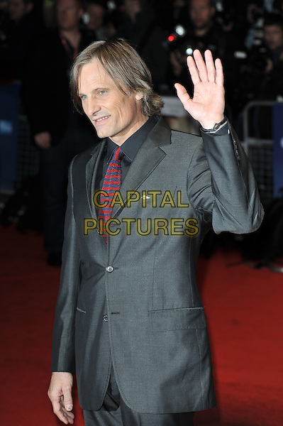 Viggo Mortensen.'A Dangerous Method' premiere, 55th BFI London Film Festival, Odeon West End cinema, Leicester Square, London, England..24th October 2011.half length suit hand waving palm profile  grey gray tie black blue red knitted .CAP/MAR.© Martin Harris/Capital Pictures.
