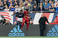 FOXBOROUGH, MA - AUGUST 31: DeJuan Jones #24 of New England Revolution and Erickson Gallardo #9 of Toronto FC battle for head ball during a game between Toronto FC and New England Revolution at Gillette Stadium on August 31, 2019 in Foxborough, Massachusetts.