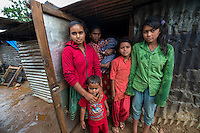 Nepal, Sindhulpalchowk District, Syaule Village.  Earthquake recovery and relief efforts during the summer monsoon rains. Families that lost their homes living in temporary shelters.