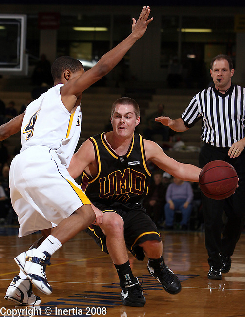 SIOUX FALLS, SD - FEBRUARY 9: Jordan Schade #10 of Minnesota Duluth tries to get around the defense of Jordan Dalton #4 of Augustana in the first half of their game Saturday night at the Elmen Center in Sioux Falls. (Photo by Dave Eggen/Inertia)