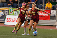 Penn's Molly McLaughlin (14) competes for the ball with Brebeuf Jesuit's Hallie Pearson (19) and Alia Martin (23) during the IHSAA Class 2A Girls Soccer State Championship Game on Saturday, Oct. 29, 2016, at Carroll Stadium in Indianapolis. Special to the Tribune/JAMES BROSHER