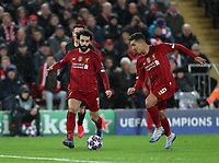 11th March 2020; Anfield, Liverpool, Merseyside, England; UEFA Champions League, Liverpool versus Atletico Madrid;  Mohammed Salah of Liverpool and Roberto Firmino of Liverpool run at the Atletico Madrid defence