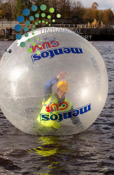 Glaswegians take to zorbing across the Clyde, giant inflatable balls a new way to commute the on the Clyde, mentos gum fresh aproacha challenge Johnny Mclauchlan/Universal News and Sport (Scotland)09/11/2010