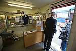 Vauxhall Motors FC 0 Solihull Moors 2, 26/04/2014. Rivacre Park, Conference North. A spectator making an enquiry in the club shop before Vauxhall Motors play Solihull Moors at Rivacre Park in the final Conference North fixture of the season. It was to be the last match for the Ellesmere Port-based home club, named after the giant car factory in the town, who have resigned from the professional pyramid system to return to local amateur football due to spiralling costs and low attendances. Their final match resulted in a 2-0 home defeat, watched by a crowd of only 215. Photo by Colin McPherson.
