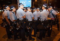 Police are seen at an overnight mass sit-in in front of Hong Kong's Central government offices, Hong Kong, China, 28 September 2014. It was announced at the student protest that the society-wide mass disobedience campaign, Occupy Central would commence immediatley - three whole days earlier than was previously forecast. The students and the Occupy Central supporters are protesting the slow pace of democratic reform imposed by the Chinese government on the Hong Kong people.