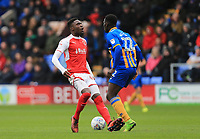 Devante Cole of Fleetwood Town upset with losing the ball against Aristote Nsiala of Shrewsbury Town during the Sky Bet League 1 match between Shrewsbury Town and Fleetwood Town at Greenhous Meadow, Shrewsbury, England on 21 October 2017. Photo by Leila Coker / PRiME Media Images.