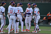 Head coach Monte Lee (18) of the Clemson University Tigers takes the ball from starting pitcher Alex Schnell in a game against the Wofford College Terriers on Tuesday, March 1, 2016, at Doug Kingsmore Stadium in Clemson, South Carolina. Clemson won, 7-0. (Tom Priddy/Four Seam Images)