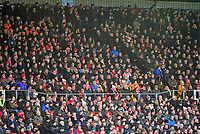 Lincoln City fans watch their team in action<br /> <br /> Photographer Andrew Vaughan/CameraSport<br /> <br /> The EFL Sky Bet League Two - Lincoln City v Notts County - Saturday 13th January 2018 - Sincil Bank - Lincoln<br /> <br /> World Copyright &copy; 2018 CameraSport. All rights reserved. 43 Linden Ave. Countesthorpe. Leicester. England. LE8 5PG - Tel: +44 (0) 116 277 4147 - admin@camerasport.com - www.camerasport.com