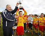14/10/2012 Tommy Molloy, Chairman of the Clare School Boys / Girls League presents the trophy to Eoghan Thynne, Captain of Avenue United after they defeated Coole FC in the ESB Moneypoint U-12 Cup Final at the County Ground on Sunday. Pic: Don Moloney/Press 22