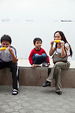 PHILIPPINES, Manila, family enjoys some corn at the Rojas Blvd Bay Walk