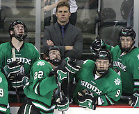 North Dakota's Derek Rodwell (left to right) and Brad Malone watch a replay of UNO's goal as Mario Lamoureux and Matt Frattin look on in disbelief. No. 4 UNO scored with three-tenths of a second remaining in regulation to beat No. 7 North Dakota 1-0 Saturday night at Qwest Center Omaha. (Photo by Michelle Bishop)