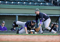Catcher Adam Martin (11) and third baseman Tyler White (20) of the Western Carolina Catamounts in a game against the Cincinnati Bearcats on Sunday, February 24, 2013, at Fluor Field in Greenville, South Carolina. Cincinnati won in 10 innings, 7-6. (Tom Priddy/Four Seam Images)