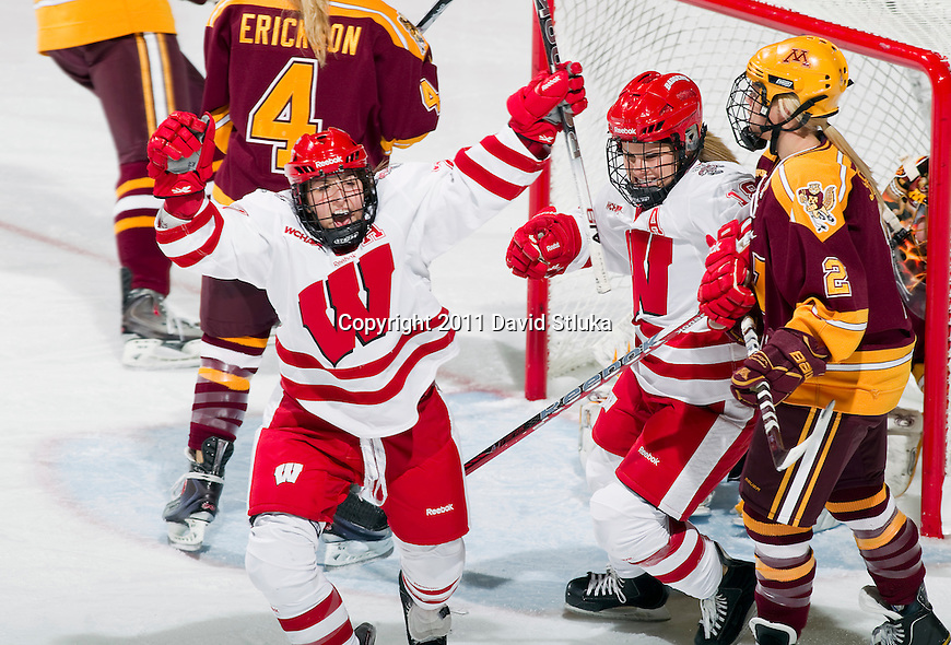 Wisconsin Badgers celebrate a goal during an NCAA women's hockey game against the Minnesota Golden Gophers on October 14, 2011 in Madison, Wisconsin. The Badgers won 3-2. (Photo by David Stluka)