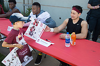 STANFORD, CA -- April 14, 2018. <br /> Harry Schwartz with fan after the 2018 Stanford Spring Football game Saturday afternoon at the Laird Q. Cagan Stadium.