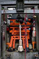 red gates called Torii in Fushimi Inari Taisha temple complex near Kyoto, Japan