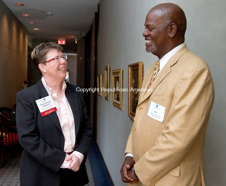 WATERBURY, CT. 25 April 2008-042508SV01--Joan McDonald, Commissioner of Department of Economic and Community Development, talks with Dr. James H. Gatling of New Opportunities Inc. during the Economic Growth breakfast of the Greater Waterbury Chamber at the Waterbury Club in Waterbury Friday.  Steven Valenti Republican-American