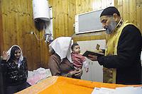 - Milano, messa per il Natale nella chiesa Copta Ortodossa Egiziana di San Marco, battesimo di un bambino<br /> <br /> - Milan, Mass for Christmas in the Egyptian Coptic Orthodox church of San Marco, baptism of a child