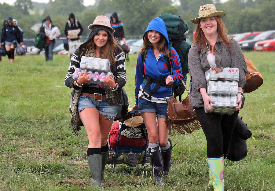 08/07/'10 Emma Kyle and Kim Gallagher and Sarah Connolly  from Bangor carrying supplies pictured arriving at Punchestown, Co. Kildare this evening for the start of the Oxegen Festival 2010...Picture Colin Keegan, Collins, Dublin