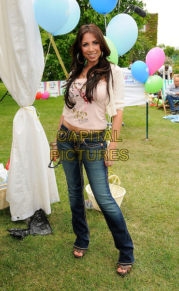 FRANCINE LEWIS.The National Family Week launch, VIP picnic, Regents Park, London, England..May 25th, 2009.full length jeans denim white cream top .CAP/CAN.©Can Nguyen/Capital Pictures.