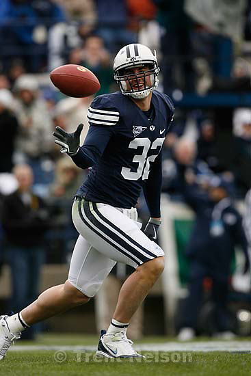 BYU's Dennis Pitta (32) scores in the first half. BYU vs. Air Force college football Saturday, November 21 2009.