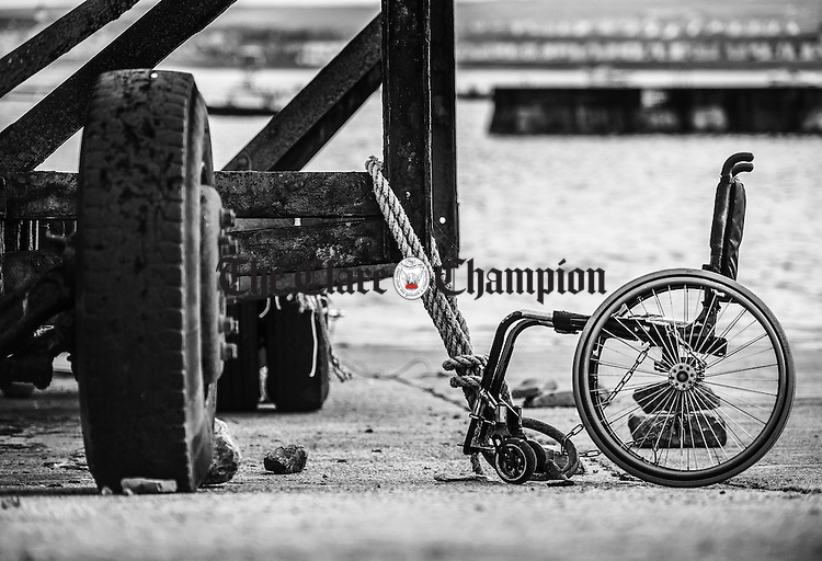 Gone Fishing?<br /> A wheelchair tied up to a boat trailer at the slipway in Kilkee, Co. Clare, appears to ask more questions than it answers.