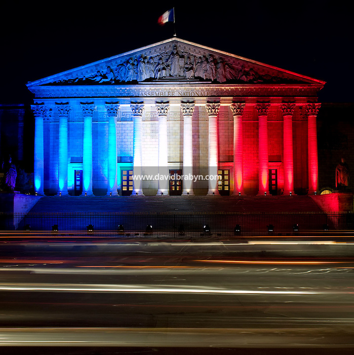 View of the Palais Bourbon, home of the French Parliament, in Paris, France, 11 July 2007, lit in the colors of the national flag, red, white and blue, ahead of the Bastille Day celebrations on the 14th July.